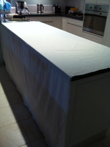 Old 100% cotton sheet folded in half across the bench.  Sprayed all over with alum.