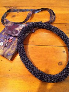 Purple necklace from a Teresa Dair kit (27% metal; 73% rayon).  Knitted.