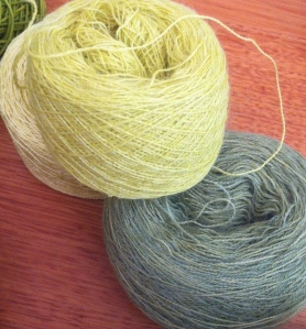 Alpaca and silk dyed in three shades of blackened yellow , each one diluted by the addition of 2 cups of water.