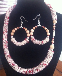 A mix of cream beads with some tan and some red crocheted with cream cotton embroidery thread